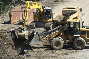 excavation and trenching safety - bulldozer and crane digging