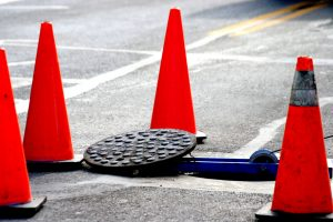 guarding floor and wall openings - traffic cones around open manhole
