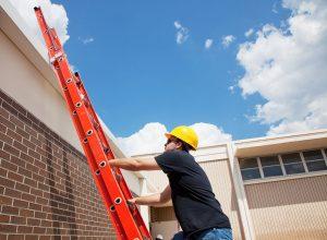 ladder safety - man climbing ladder