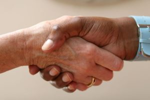 respect in the workplace - people shaking hands