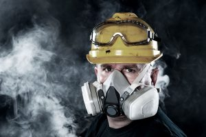 respiratory protection - man wearing a respirator mask