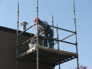 scaffold safety - worker standing on scaffold