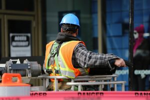 Construction worker using safety equipment